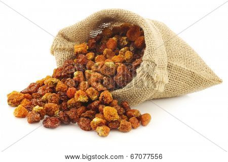 Dried Cape gooseberries (Physalis peruviana) in a burlap bag  on white background