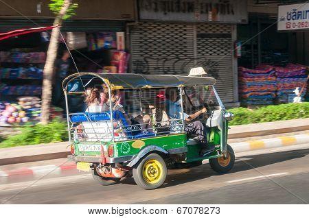 Bangkok, Thailand - May 23, 2014: Unidentified Driver And Tourists In Tuk-tuk Vehicle Along The Road