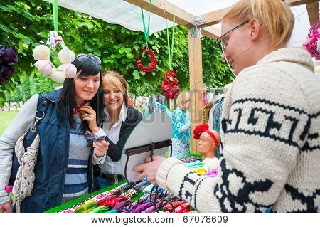 MOSCOW - JUNE 14: People buy handmade souvenirs on XI International Jazz Festival