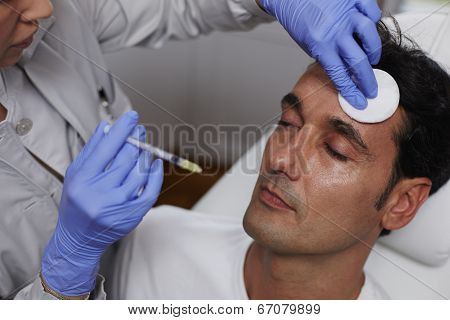 Man having wrinkles removed in a beauty clinic