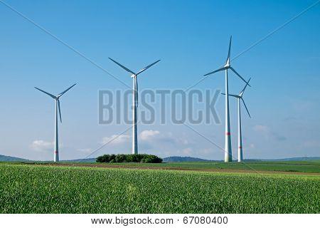 Windwheels under a blue sky