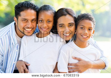 portrait of beautiful indian family outdoors