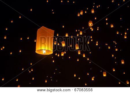 Floating sky lanterns during Yi Peng Festival in Chiang Mai, Thailand