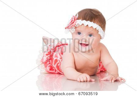 Cute Smiling Baby Girl In A Pink Dress