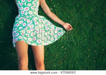 Young Woman In Dress Lying On Gerass