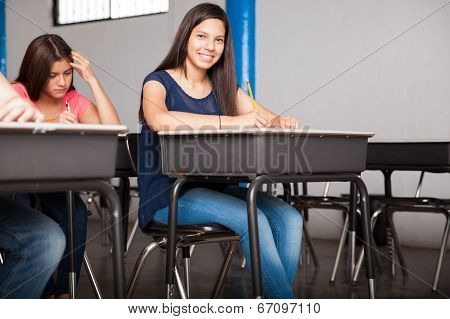 Cute Girl Taking A Test At School