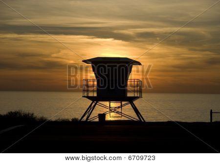 Lifeguard hut at sunset along the coast