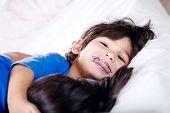 picture of physically handicapped  - Disabled little boy hugging sister on bed - JPG