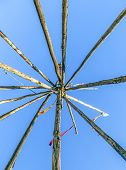 foto of tipi  - Tipee stakes and ribbons shown against a blue sky - JPG
