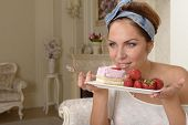 picture of blouse  - Yung woman in white blouse eating strawberry cake