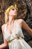 foto of tunic  - Beautiful makeup girl wearing white tunic and an antique jewels rocky wall on background - JPG
