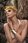 picture of tunic  - Beautiful makeup girl wearing white tunic and an antique jewels rocky wall on background - JPG
