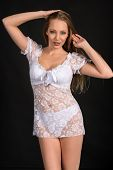 stock photo of chemise  - Beautiful slender blonde in a white lace chemise - JPG