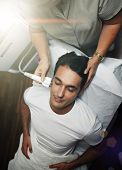 image of average man  - dult man making laser procedure at beauty salon