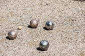 foto of sand gravel  - Petanque balls closeup on sand gravel alley background - JPG