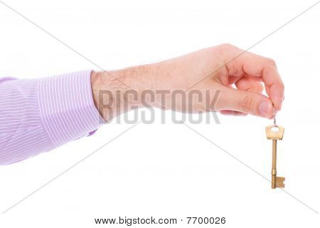 Hand Holds House Door Key