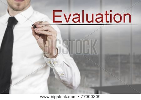 Businessman Writing Evaluation In The Air