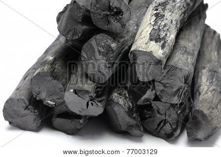 kishu binchotan, japanese traditional white charcoal isolated on white background