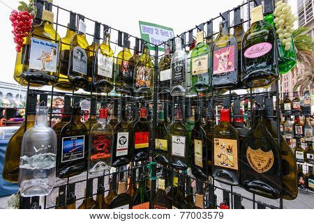 Rack with empty flat souvenir popular alcohol drinks bottles for tourist shopping