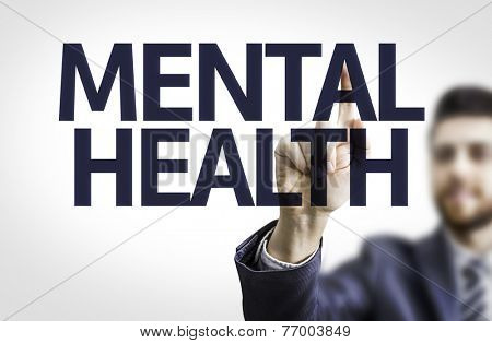 Business man pointing to transparent board with text: Mental Health