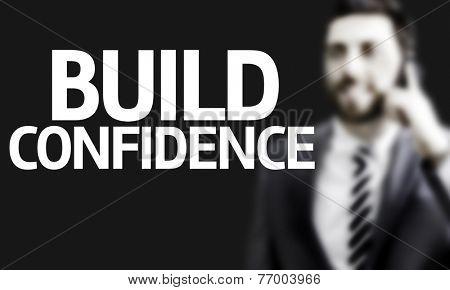 Business man with the text Build Confidence in a concept image