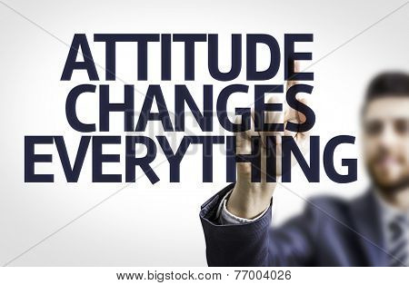 Business man pointing to transparent board with text: Attitude Changes Everything