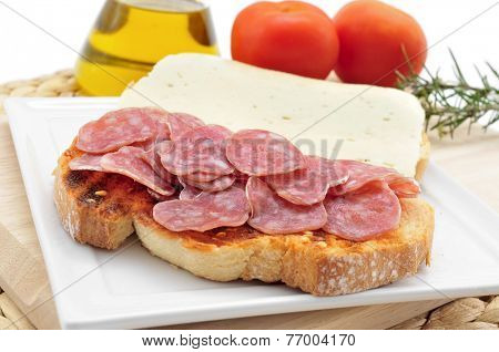 closeup of pa amb tomaquet amb fuet, bread with tomato and a typical sausage of Catalonia, Spain