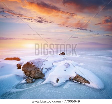 Stone on ice. Winter landscape.
