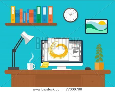 Workplace with laptop and documents