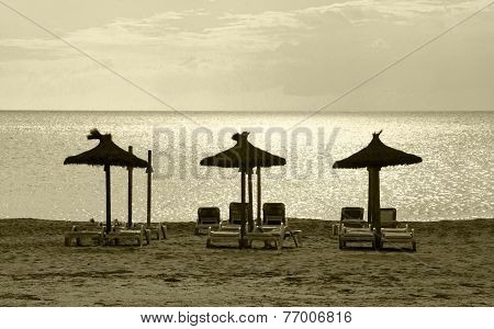 Three parasols beach