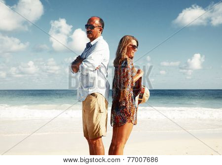 Unhappy couple on the beach. Divorce and separation