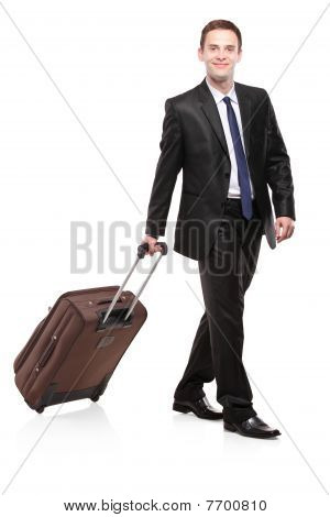 Business traveller carrying a suitcase