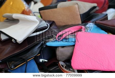 Leather Bags Of Various Sizes On Sale In The Market Stall