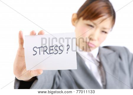 businesswoman showing a card with word  STRESS?