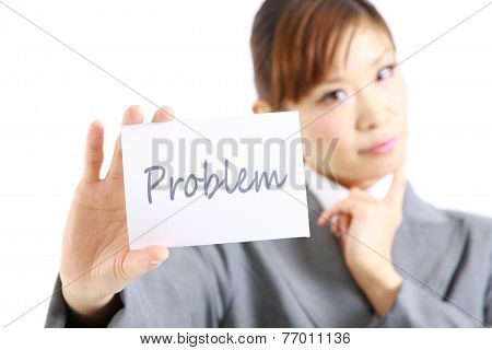 businesswoman showing a card with word  PLOBLEM?