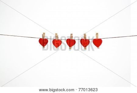 Little red hearts hanging on a string
