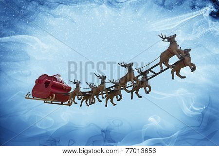Santa Claus riding a sleigh led by reindeers on a colorful night with a full moon
