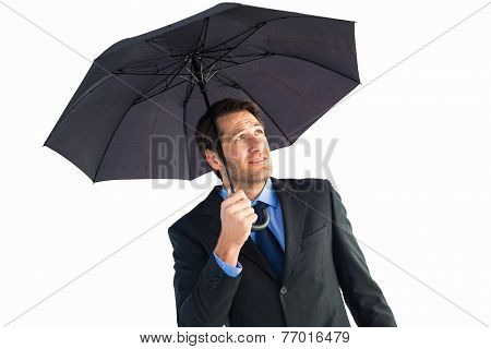 Businessman sheltering with black umbrella on white background