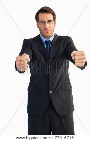 Businessman standing with clenched fists on white background
