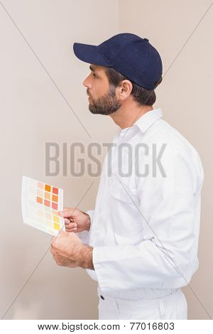 Painter holding a colour chart in a new house
