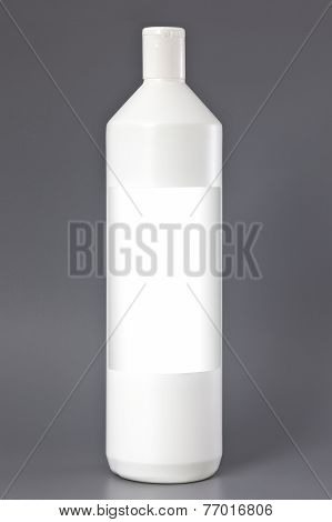 Cleaning Products. Detergent Plastic Bottle Isolated On Gray Background, With Blank For Text.
