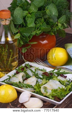 White fish (tooth fish) with salad, fresh herbs