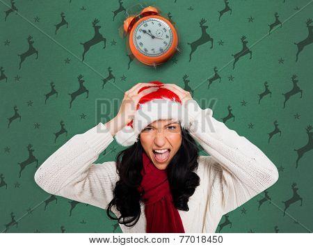 Irritated woman looking at camera against green reindeer pattern