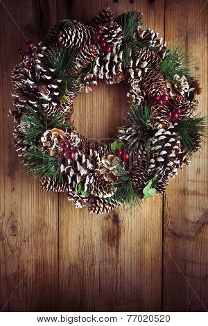 Christmas Wreath On A Rustic Wooden Door