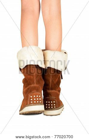 Girls Legs In Boots Isolated On The White Background