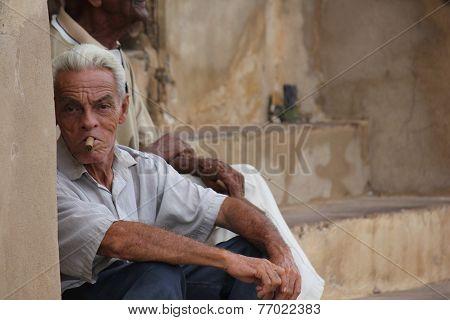 Old Man Smoking Cigar.