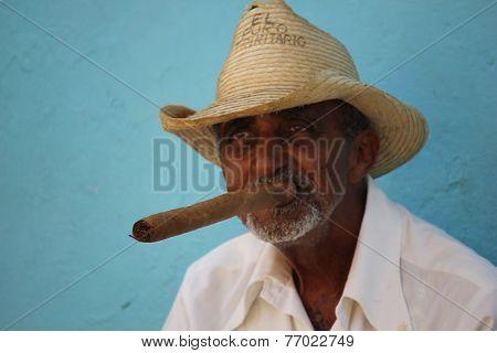 Old Man Smoking A Typical Cuban Cigar.