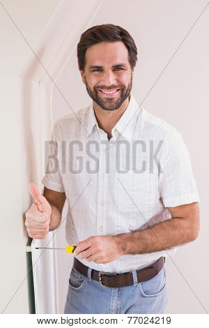 Handyman hanging up a radiator in a new house