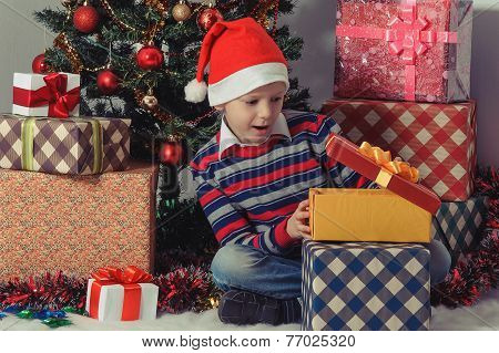 Happy Boy Opening A Present Box