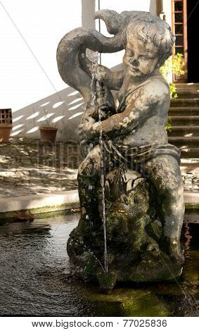 Cherub statue with fountain
